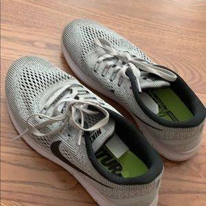 Nike running shoes in grey